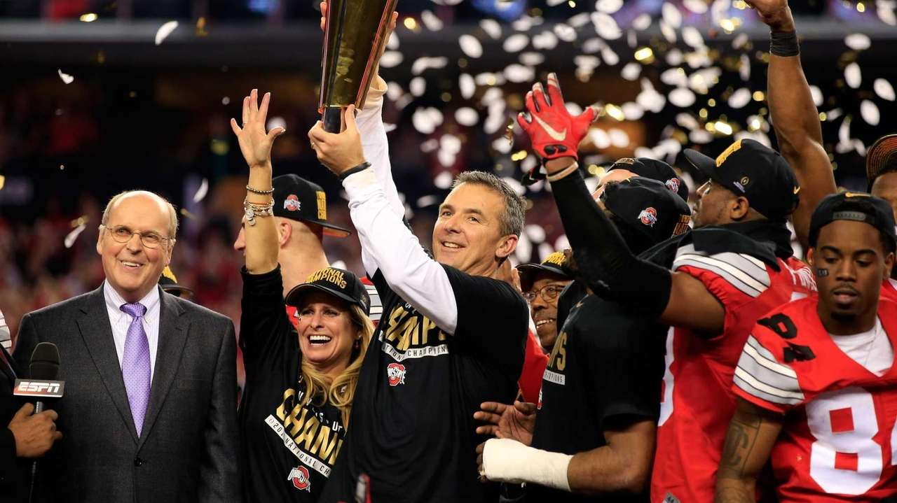 Ohio State head coach Urban Meyer hoists the