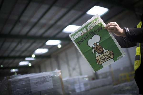 A person reads the forthcoming edition of the