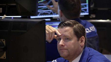 Trader Gregg Maloney works on the floor of