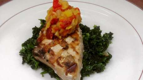 Grilled swordfish over sauteed spinach with pineapple red
