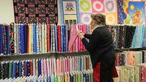 Peggy Petrucco takes inventory of the fabrics at