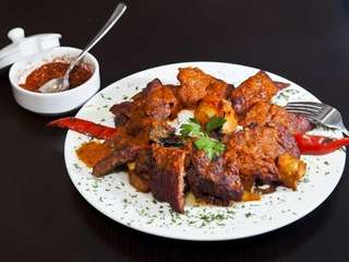 Adana kebab, ground lamb flavored with red bell