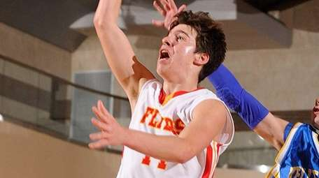 Chaminade's Owen Prendergast, left, drives to the hoop