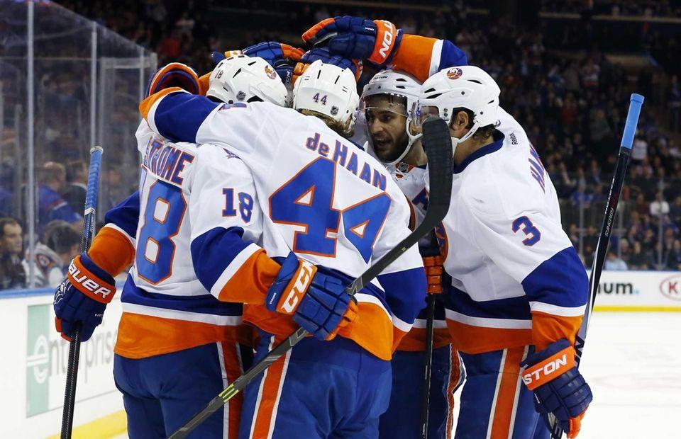 The New York Islanders celebrate their first goal