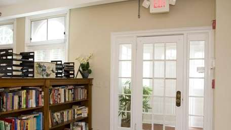 This is the front entrance and bookcase that