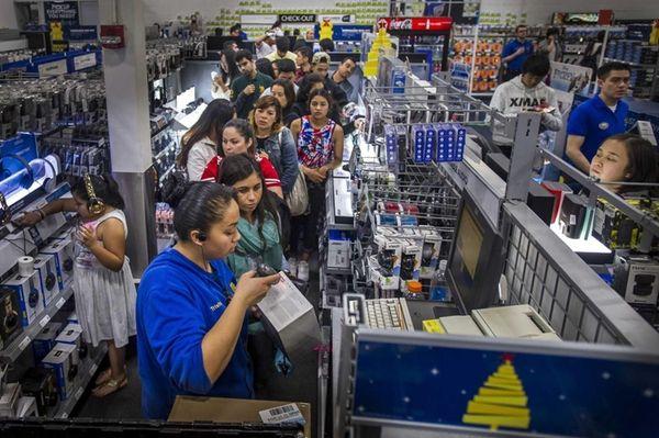A shopper wait to purchase Beats Electronics LLC