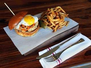 "The ""kimchi burger"" is a chicken patty, with"