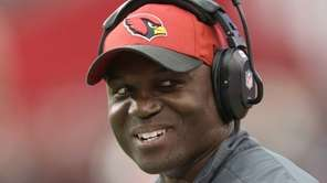 Arizona Cardinals defensive coordinator Todd Bowles looks up