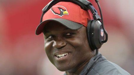 Arizona Cardinals defensive coordinator Todd Bowles looks up