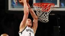 Mason Plumlee of the Brooklyn Nets goes to