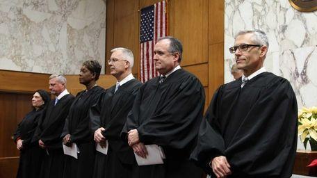 (L-R) Supreme Court Judges Anna Anzalone, Angelo Delligatti,