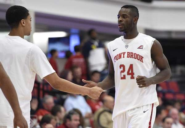 Stony Brook Seawolves guard/forward Roland Nyama is greeted