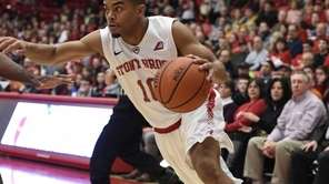 Stony Brook Seawolves guard Carson Puriefoy drives to
