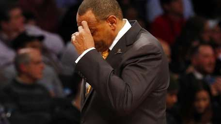 Lionel Hollins of the Brooklyn Nets looks on