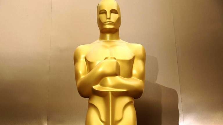 An Oscar statue stands on the red carpet