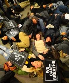 "Protesters stage a ""die-in"" at the Fifth Avenue"