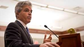Suffolk County Executive Steve Bellone speaks as members