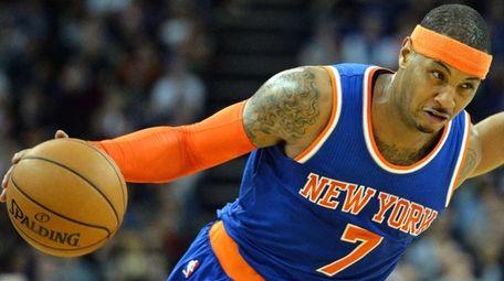 The New York Knicks' Carmelo Anthony, left, runs