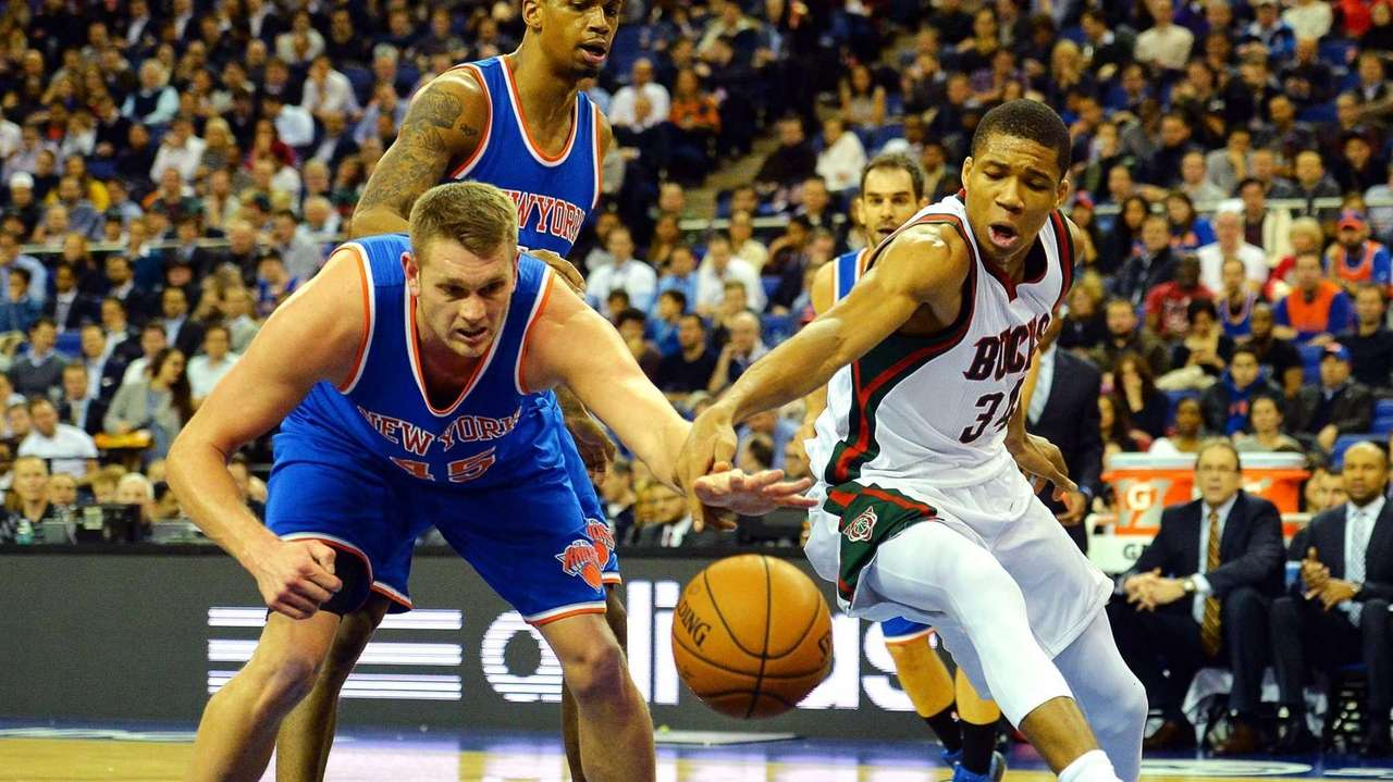 Milwaukee Bucks' Giannis Antetokounmpo challenges New York Knicks'