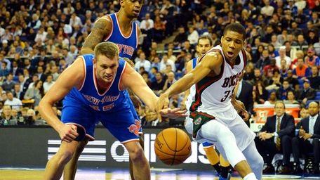 Milwaukee Bucks' Giannis Antetokounmpo challenges New York Knicks'