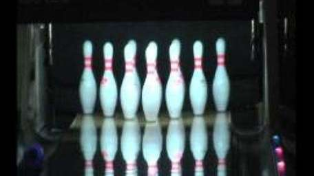 Bowling pins are seen in this stock image.