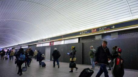 Commuters at Penn Station walk past closed restaurants