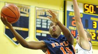 Great Neck South's Kendell Francis draws a foul