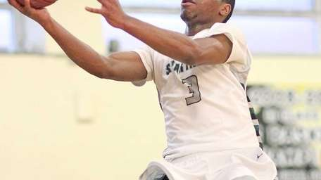 Elmont's Chiazam Nwankwo gets the basket during a
