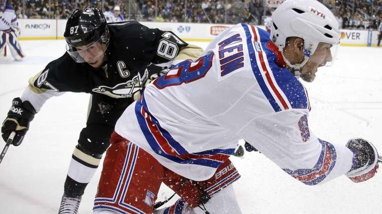New York Rangers' Kevin Klein (8) beats Pittsburgh