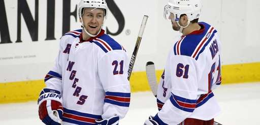 New York Rangers' Derek Stepan (21) and Rick