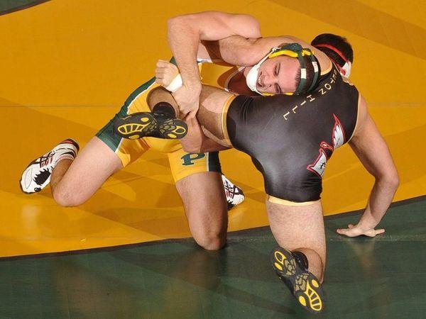 LIU Post grappler Chris Dilorio, left, battles Morris