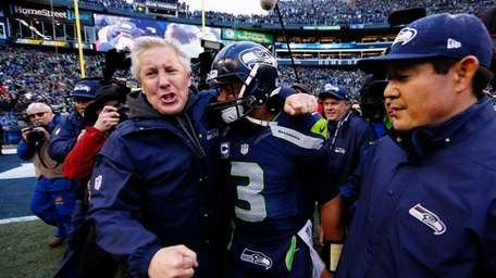 Head coach Pete Carroll and Russell Wilson of