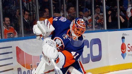 Jaroslav Halak of the New York Islanders shoots