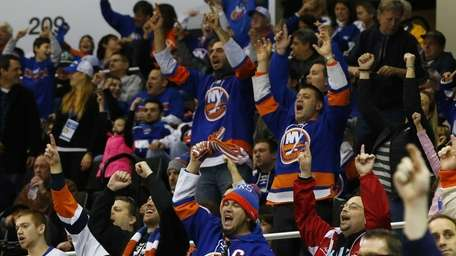 Fans cheer after a New York Islanders' third-period