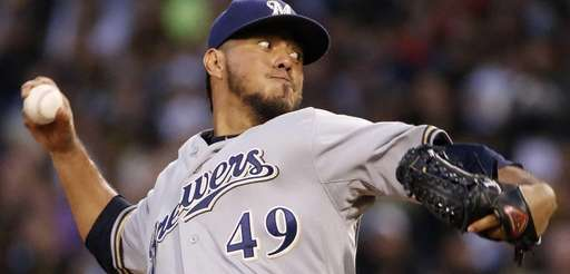 Milwaukee Brewers starting pitcher Yovani Gallardo delivers during