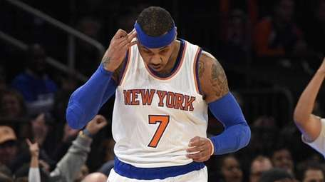 New York Knicks forward Carmelo Anthony reacts after