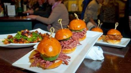 Corned beef sliders with pickles are irresistible at