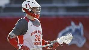Stony Brook University midfielder Frank Lucatuorto follows the