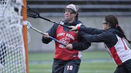 Stony Brook attacker Courtney Murphy shoots past her