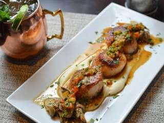 Pan-seared dry scallops are rich, with cauliflower puree,