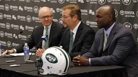 New York Jets general manager Mike Maccagnan, center,