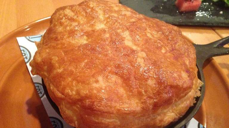 The homestyle chicken pot pie is served in