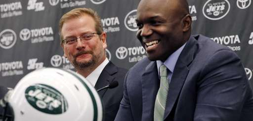 New York Jets general manager Mike Maccagnan, left,