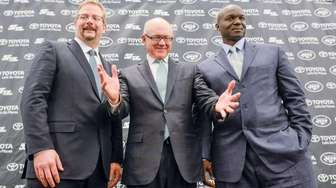 New York Jets Owner Woody Johnson (center) presents