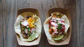 Soft white-corn tacos are served at Tres Carnes,