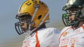 LSU offensive tackle La'el Collins looks on during