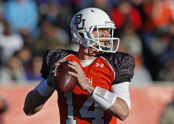 Baylor quarterback Bryce Petty (14) sets back to