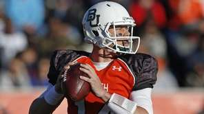 Baylor quarterback Bryce Petty (14) sets back to