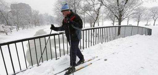 Irv Rosenberg, of Boston, uses cross country skis