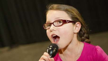 Emily De Martin, 8, rehearses for the upcoming